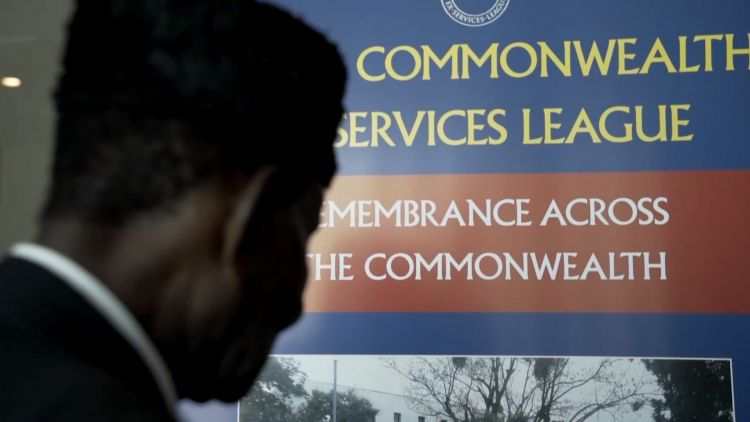 Black Veteran with Commonwealth Ex-Services League sign