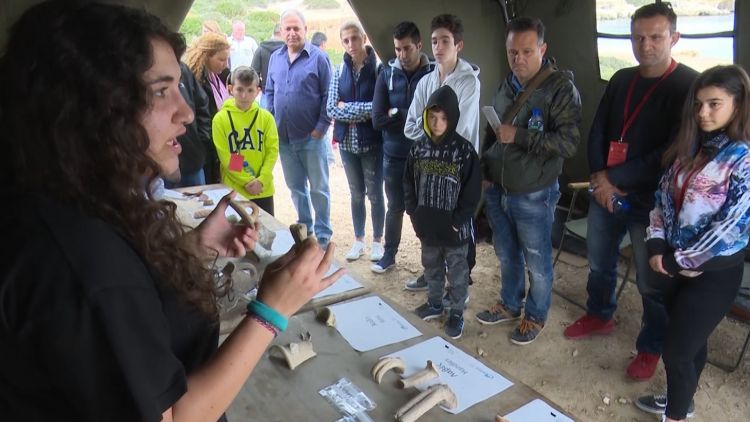 Archaeologist with locals and artifacts from site of ancient Roman port at RAF Akrotiri in Cyprus
