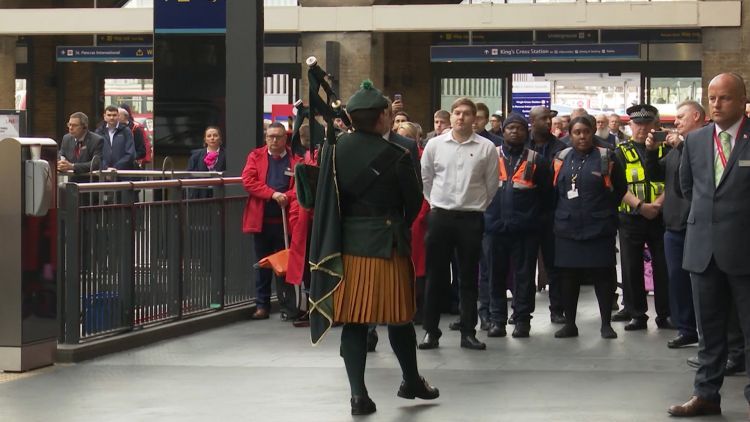 Piper performs last post at Kings Cross Station