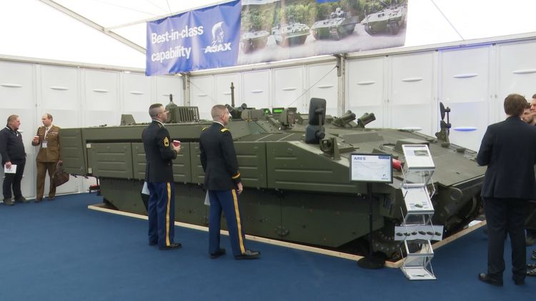 Next Generation Of Military Vehicles Are Showcased At London Exhibition Soldiers look at Kit 230119 CREDIT BFBS .jpg