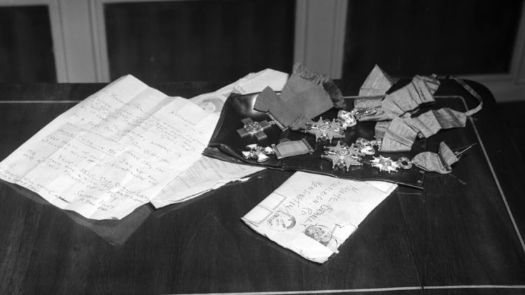 The letter and medals which were returned to Odette and Peter after they were stolen by thieves (Picture: Mirrorpix).