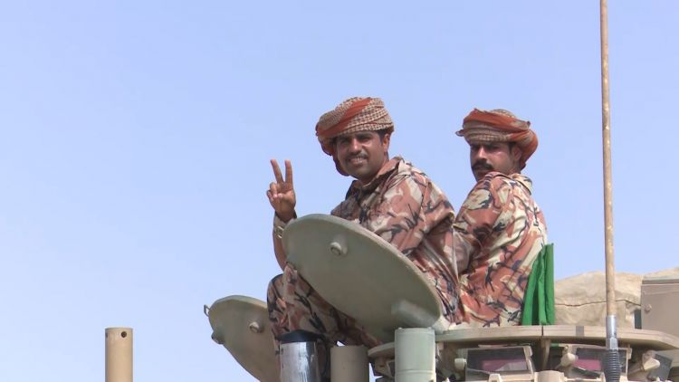 Omani troops on their Challenger 2 tanks.