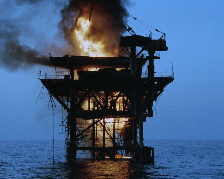 Iranian oil platform on fire after being shelled by five US frigates. (Image: US Navy)
