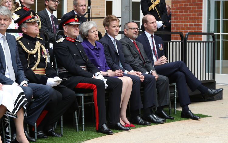 (left to right) Lord Howe, Sir John Peace, Prime Minister Theresa May, Hugh Grosvenor, 7th Duke of Westminster, Prince Salman bin Hamad bin Isa Al Khalifa and the Duke of Cambridge attend the official handover to the nation of the newly built Defence and National Rehabilitation Centre (DNRC) at the Stanford Hall Estate, Nottinghamshire.