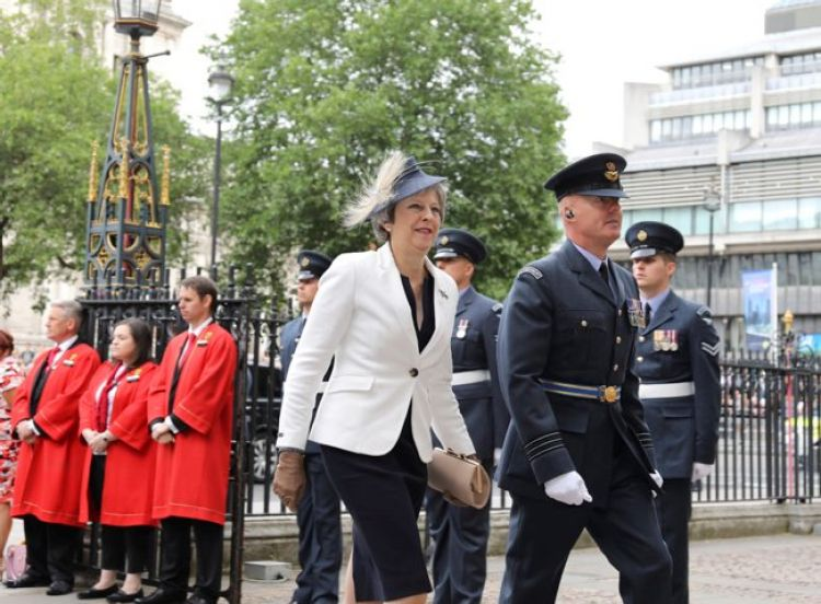 Prime Minister Theresa May arrives at the RAF100 Celebration Ceremony at Westminster Abbey CREDIT MOD.jpg