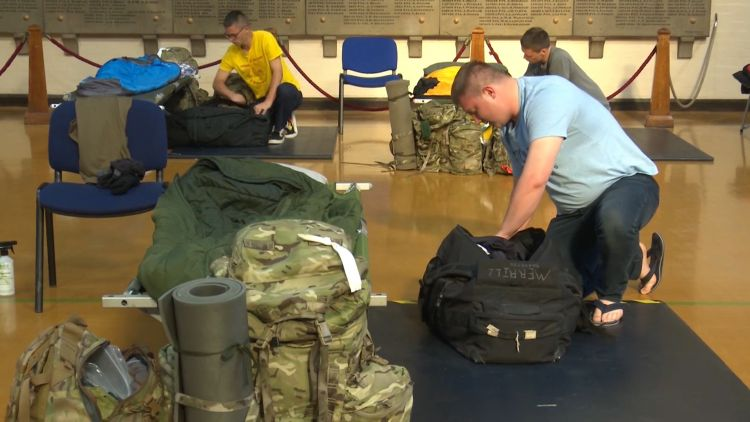 Reservists in Army Reservist centre with luggage during COVID pandemic 150620 CREDIT BFBS.jpg
