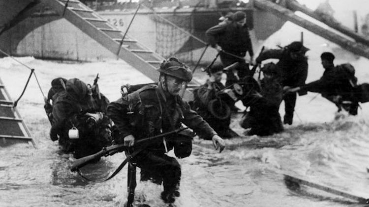 Royal Marine Commandos going ashore as part of D-Day (Picture: PA).