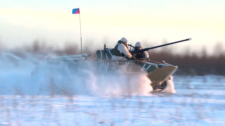 Russian troops drive through the Arctic 300119 CREDIT Russian MOD.jpg