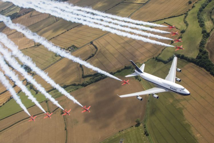 the Royal Air Force Aerobatic team, the Red Arrows and a British Airways Boeing 747, seen here carrying out a flypast over the Royal International Air Tattoo at RAF Fairford.