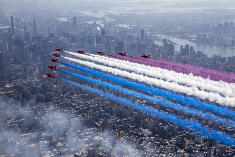the Royal Air Force Aerobatic Team, The Red Arrows flying over New York streaming the Red, White and Blue.