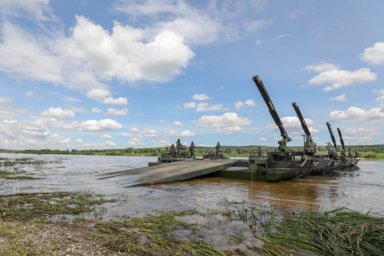The 130th Deutsch Engineer Battalion successfully utilizes its amphibious assets to build a ferry