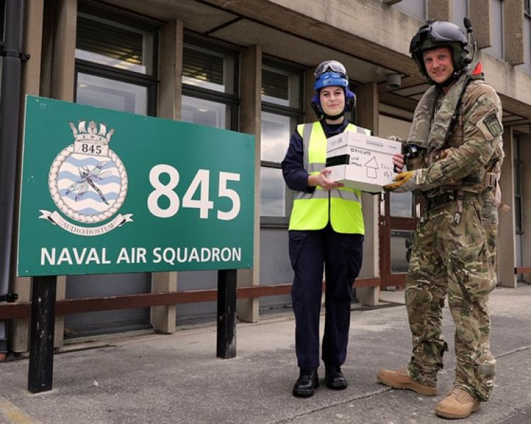 Sergeant Howling handing over the chicks saved from HMS Queen Elizabeth to AB Jones at 845 NAS, RNAS Yeovilton (Picture: Royal Navy).