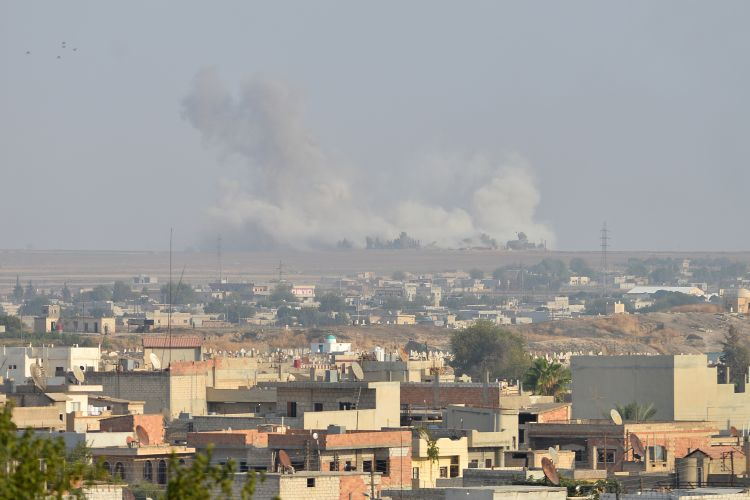 Smoke rises from the Syrian city of Ras al Ain following an attack from Turkey 101019 CREDIT PA