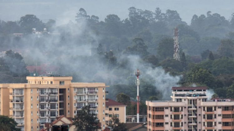 Smoke rises from the blast area after an attack at an upmarket hotel and office complex in Nairobi (Picture: PA).