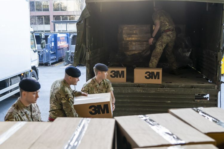 Members of $ Regiment RLC deliver 40,000 surgical masks to St Thomas' Hospital in London (Picture: MOD).