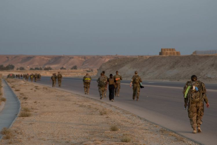 Soldiers, Civilians, and Coalition forces deployed in Iraq in support of  Operation Inherent Resolve participate in a Danish Contingency March at Al Asad Air Base in Iraq