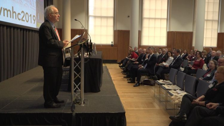 A speaker addresses guests at the Veterans Mental Health Conference in London