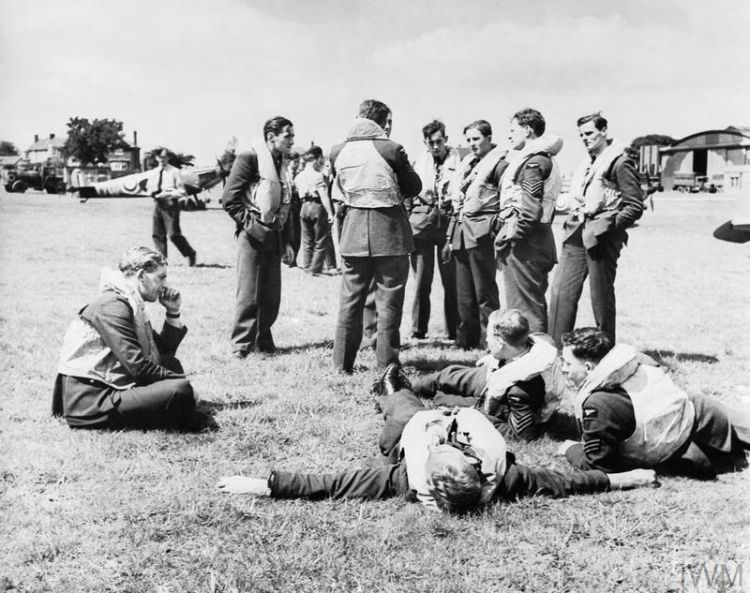Spitfire pilots relax between sorties during World War Two (Picture: Imperial War Museum).