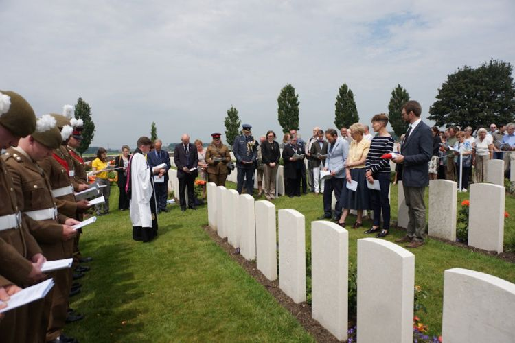 The family of Capt Kington and soldiers of The Royal Welsh participate in the rededication service