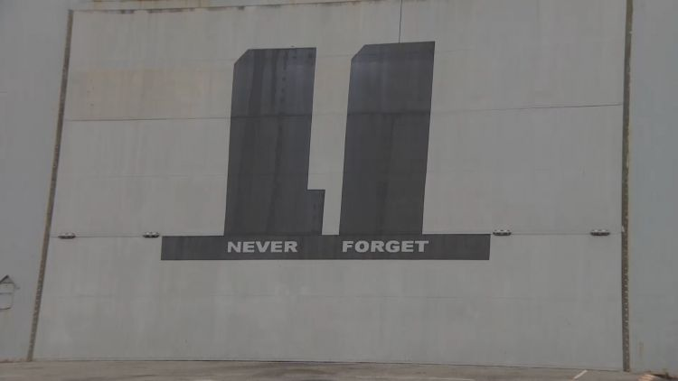 "The silhouette of the Twin Towers and ""never forget"" on the ship."