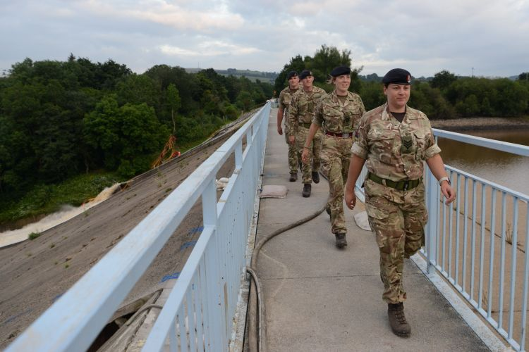 Soldiers walk across Whaley Bridge Dam (Picture: MOD).