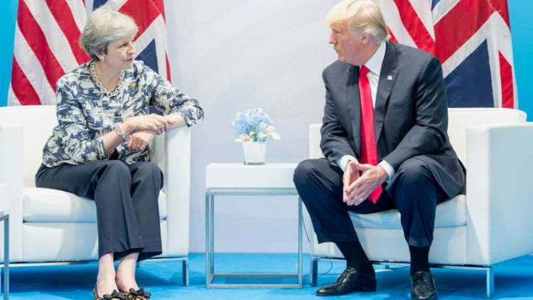 Theresa May pictured alongside President Trump