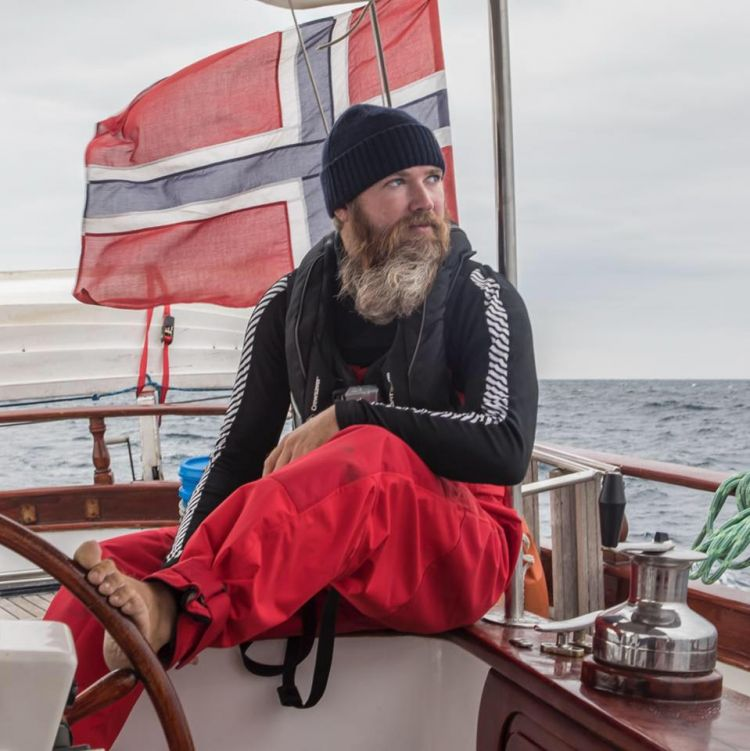 Jan from Norway takes control of the tiller (image: Turn to Starboard)
