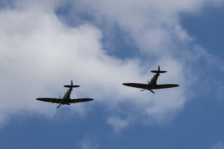 Two Battle of Britain Memorial Flight Spitfires fly over Ditchling in honour of Dame Vera Lynn