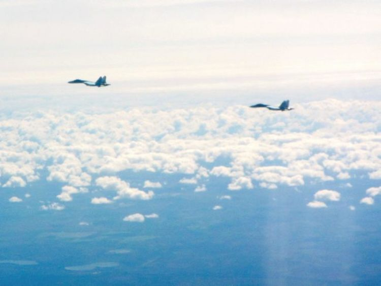 Two Russian SU-27 Flanker aircraft, flying along the Baltic coast