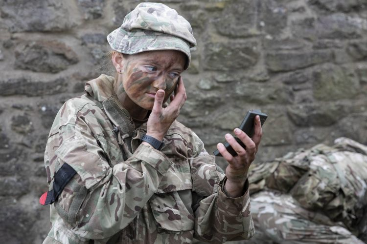 Patrol Commander Isobel Thomson applies cam-cream. Credit: Georgina Coupe, BFBS.