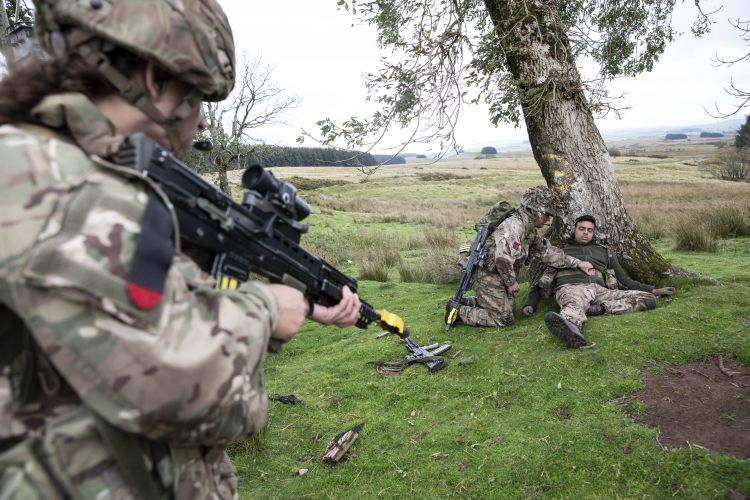 Members of the team search 'enemy' after a Section Attack serial. Credit: Georgina Coupe, BFBS.