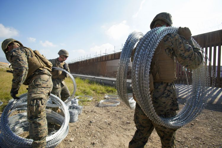 US Marines working on fence in San Diego at border with Mexico