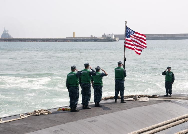 US submariners raising flag South Korea
