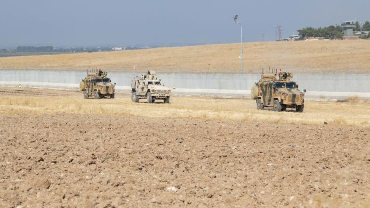 US and Turkish military forces conduct ground patrol in north-east Syria