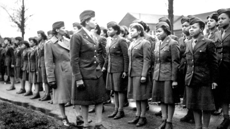 Major Charity E Adams and Captain Abbie N Campbell inspect the first contingent of black members of the Women's Army Corps assigned to overseas service. Credit U.S. National Archives and Records Administration