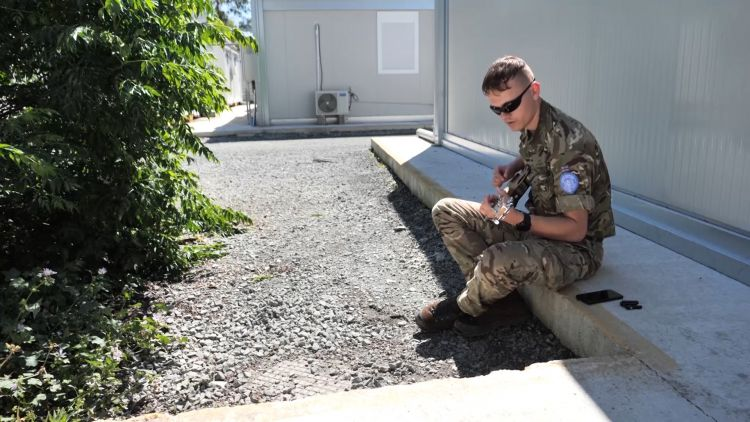 Uk troop plays guitar in Cyprus during op Tosca deploument USED ON 290520 CREDIT 7 Rifles.jpg