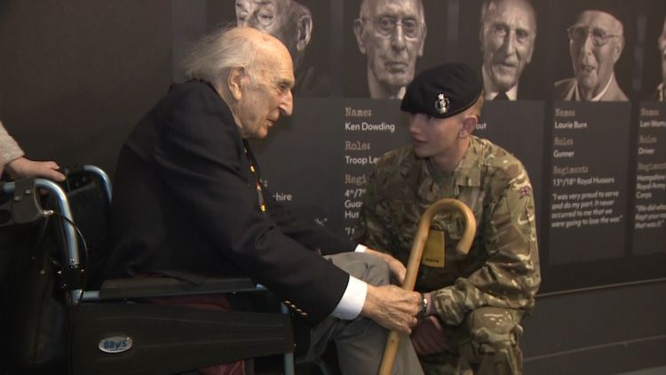 WWII Veteran Ken Tout speaks to a young soldier 040419 CREDIT BFBS.jpg