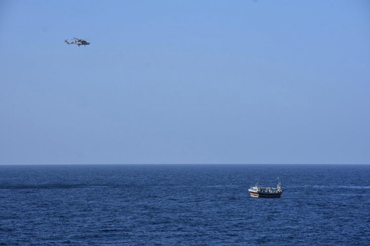 Wildcat helicopter over suspect vessel 040319 CREDIT Royal Navy.