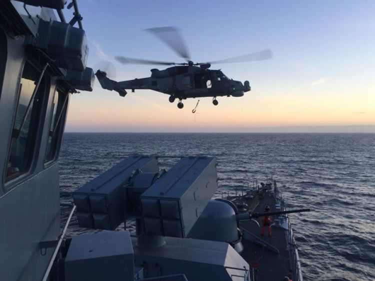 Royal Navy warship and Wildcat helicopter
