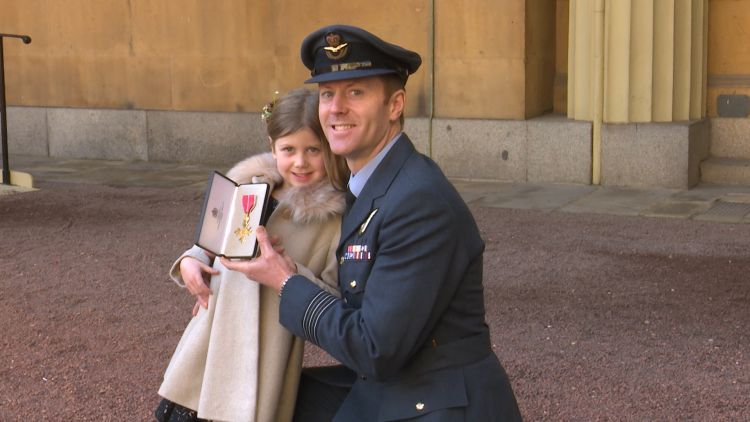 Wing Commander Gatland and his daughter at the investiture ceremony 210219 CREDIT BFBS