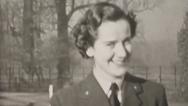 Woman smiling to the camera WWII MI6 Whaddon Hall footage 030420 CREDIT Bletchley Park YouTube.jpg