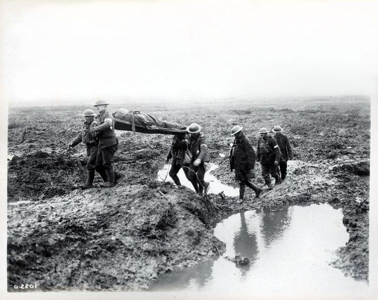 A wounded Canadian soldier being taken to an aid post (image: William Rider-Rider and Library and Archives Canada)