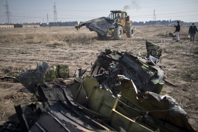 Wreckage at the site of a crash of an Iranian Boeing 737 jet about 30 miles south of Tehran, Wednesday, January 8, 2020 CREDIT PA IMAGES 080120.jpg