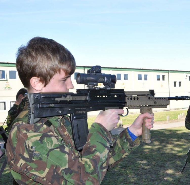 Potential recruit takes aim with a replica rifle