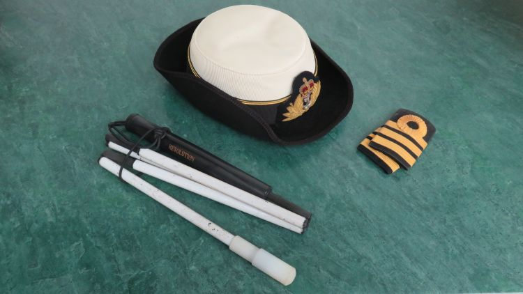 Penny's uniform, including the cane she used while still serving