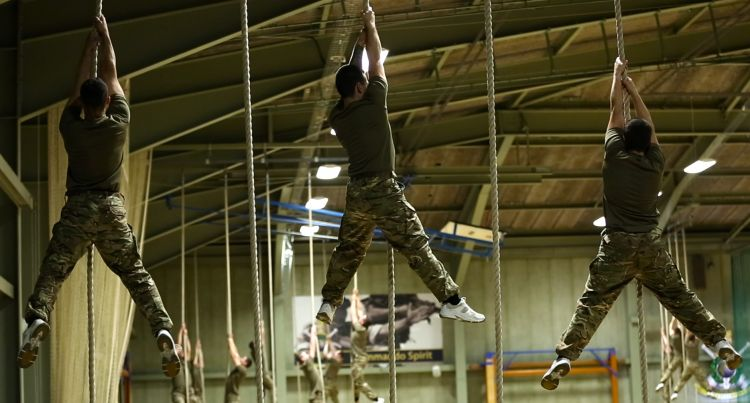 Royal Marines recruits on the ropes at Lympstone. Picture by Richard White, FMA student