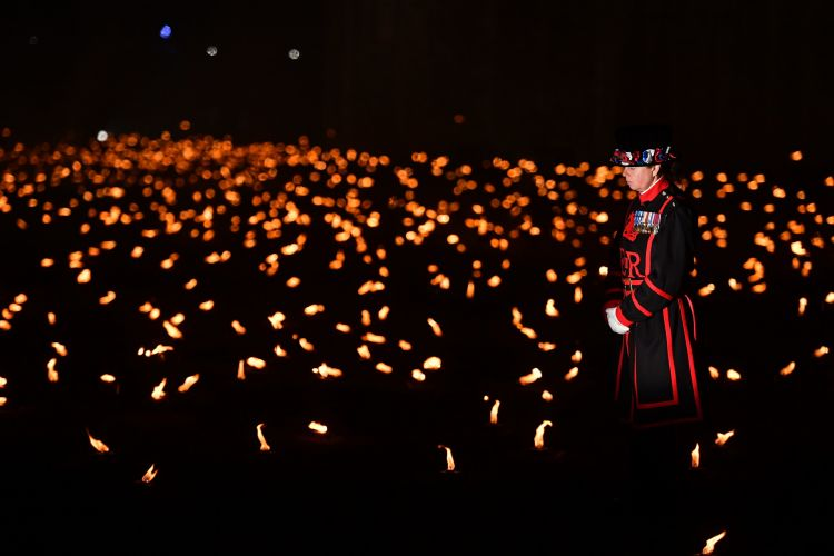 Thousands of flames have been lit around the Tower of London, to remember all those lost in the First World War, and in every conflict since (Picture: PA).