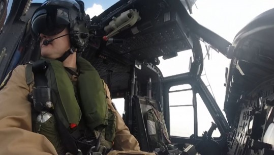 Pilot In Cockpit of Griffin Helicopter - 84 Squadron