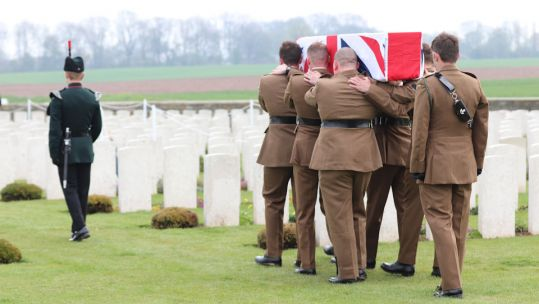 A bugler and bearer party from1 RIFLES carry Private Burt's to the graveside 150419 CREDIT Crown Copyright.jpg