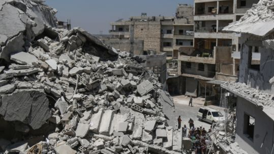A building reduced to rubble in Idlib (Picture: PA images).